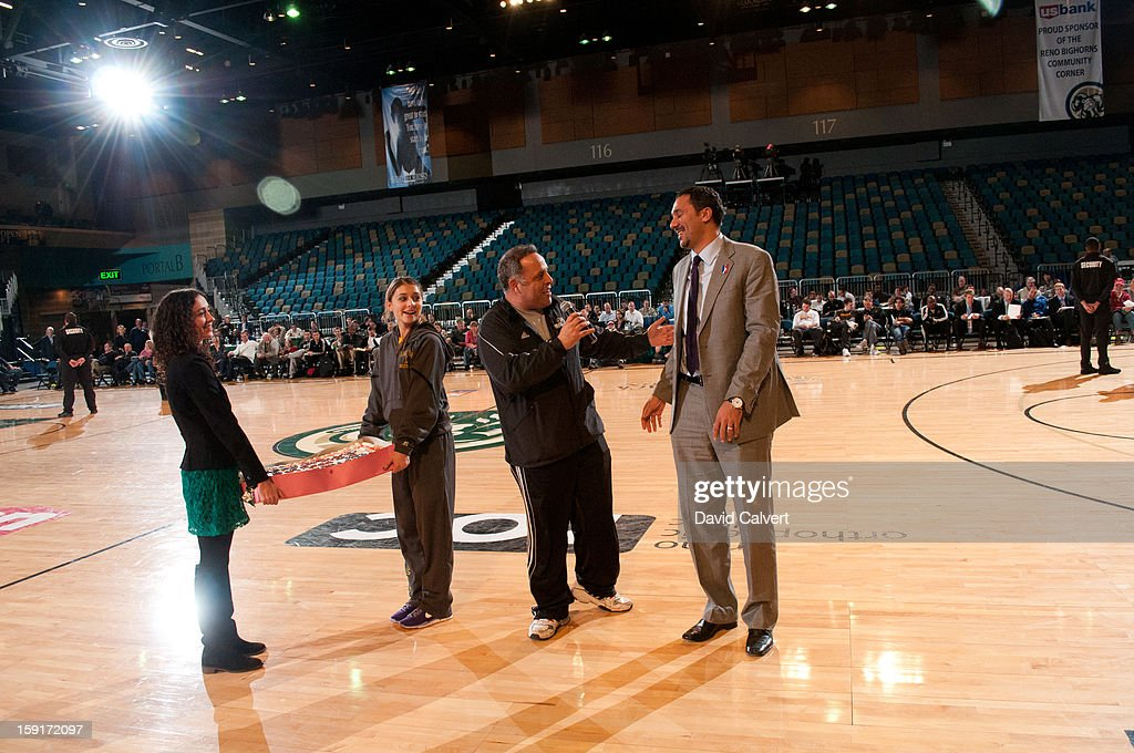 Reno Bighorns owner Herb Santos presents NBA D-League President Dan Reed with a birthday cake during a timeout out in the game between the Los Angeles D-Fenders and the Iowa Energy during the 2013 NBA D-League Showcase on January 8, 2013 at the Reno Events Center in Reno, Nevada.