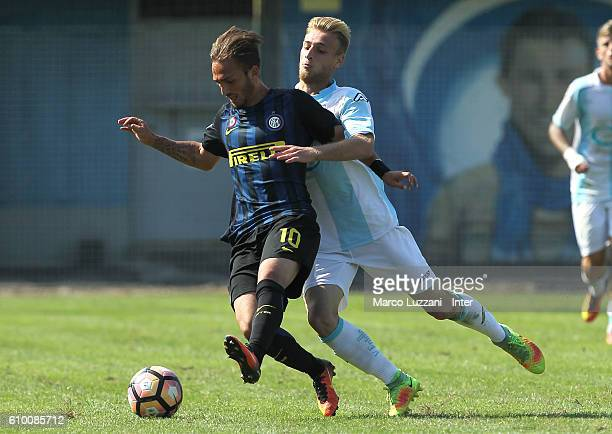 Reno Mauro Piscopo of FC Internazionale Milano is challenged during the Primavera Tim juvenile match between FC Internazionale and Virtus Entella at...