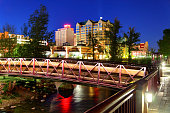 """Reno Nevada skyline on the Truckee River at night. Reno is a city in the US state of Nevada near Lake Tahoe. Known as """"The Biggest Little City in the World"""", Reno is famous for its casinos. Reno is al"""