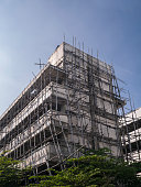 bamboo scaffold is cover old low rise condominium building in Thailand while there are renovated