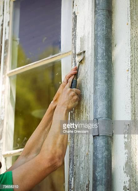 Renovating a house facade.