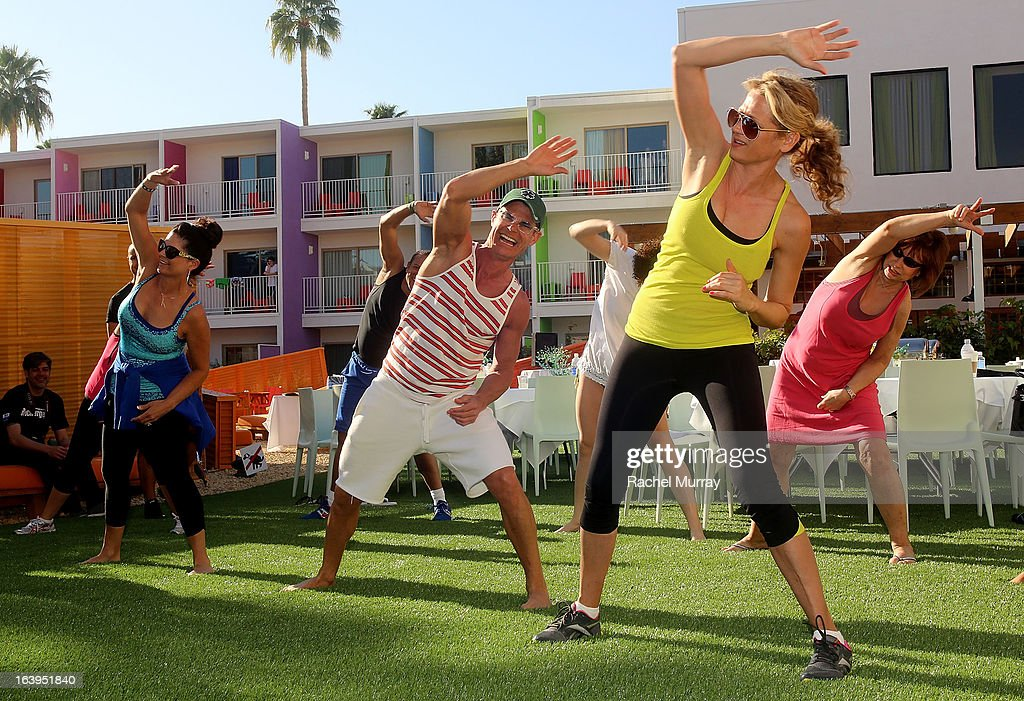 Renowned Beverly Hills hairstylist Lenny Strand (C) and guests participate in the morning self-defense and exercise class during the Bash To Banish Bullying Benefiting It Gets Better, A Matrix Chairs Of Change Event - Day 2 at Saguaro Hotel on March 17, 2013 in Palm Springs, California.