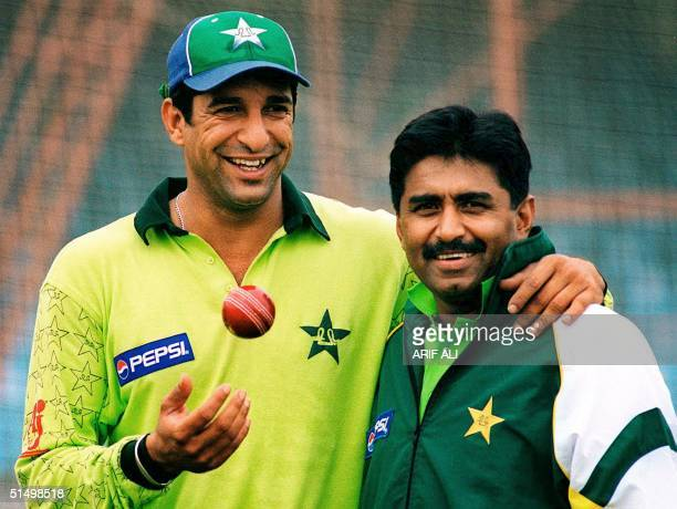 Renowned Pakistani pacer Wasim Akram toss a ball while posing with his team coach and former captain Javed Miandad in the eastern city of Lahore 26...
