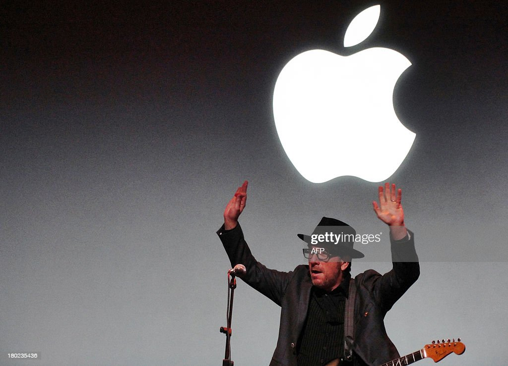 Renowned rocker Elvis Costello closes out an iPhone event at Apple's headquarters in Silicon Valley on September 10, 2013 in Cupertino, California. Apple unveiled two new iPhones on Tuesday in its bid to expand its share of the smartphone market, including one as low as $99 with a US carrier contract. 'The business has become so large that this year we are going to replace the iPhone 5 and we are going to replace it with two new designs,' Apple chief Tim Cook announced at the company's Silicon Valley headquarters. Apple will begin taking orders on Friday, and on September 20 the two devices will go on sale in the United States, Australia, Britain, China, France, Germany, Japan and Singapore. AFP PHOTO/GLENN CHAPMAN