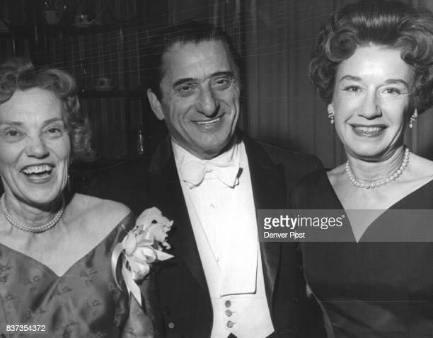 Renowned tenor Jan Peerce is pictured at the afterconcert party with Mrs Braxton Ross and Mrs Charles Sterne The performance of the Bach Group was...