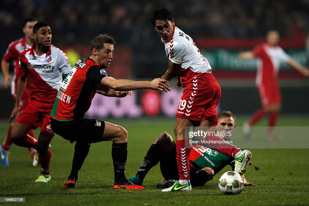 Rens Van Eijden of NEC and Adam Sarota of Utrecht battle for the ball during the Eredivisie match between NEC Nijmegen and FC Utrecht at the McDOS Goffertstadion on November 24, 2012 in Nijmegen, Netherlands.