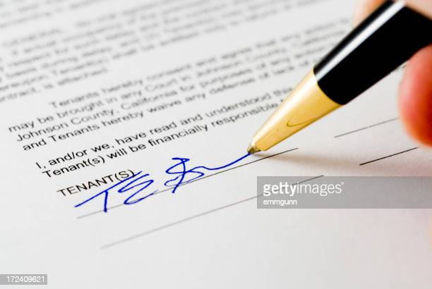 Rental agreement form with blue ink pen