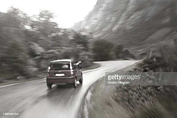 Rental car driving on a tourist road