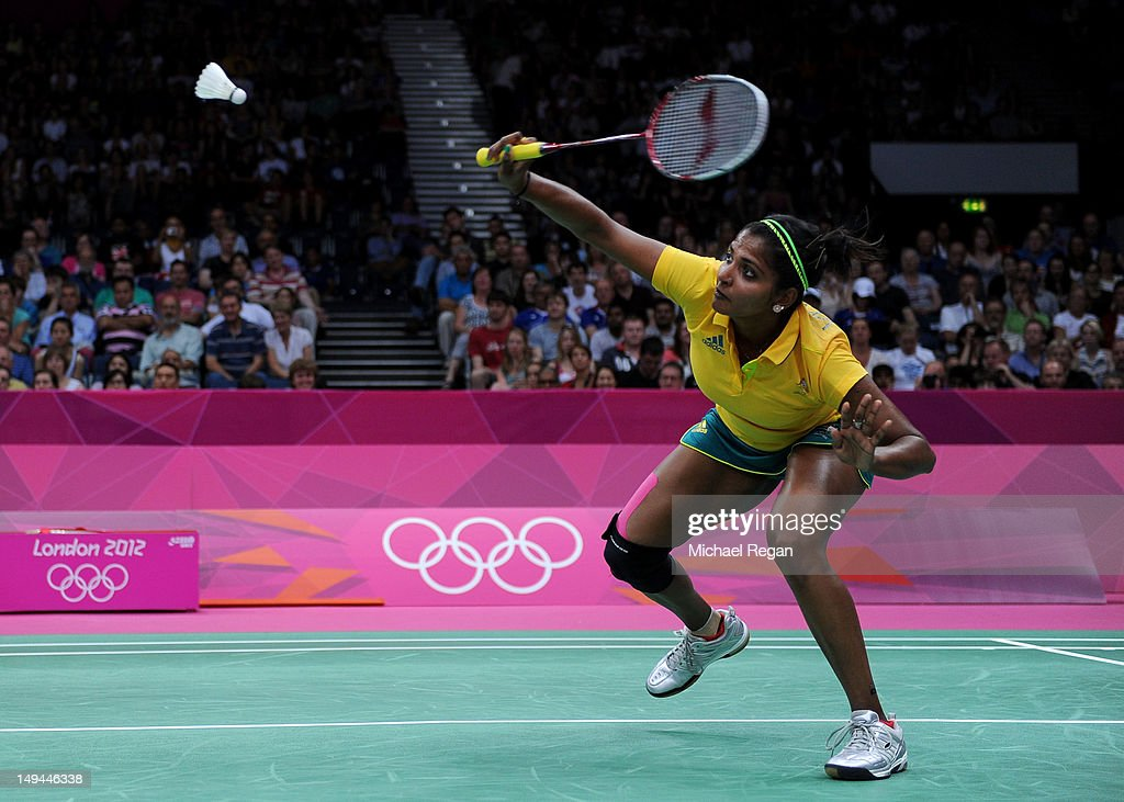 Renuga Veeran of Australia returns a shot against Greysia Polii and Meiliana Jauhari of Indonesia during their Women's Doubles Badminton on Day 1 of the London 2012 Olympic Games at Wembley Arena on July 28, 2012 in London, England.