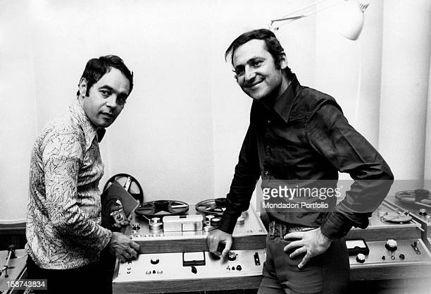 Renzo Arbore and Gianni Boncompagni are in the radio studio both looking in the same direction Rome Italy 1970