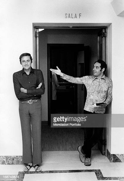 Renzo Arbore and Gianni Boncompagni standing under the entry door of a recording studio Gianni Boncompagni indicates with the hand Renzo Arbore who...