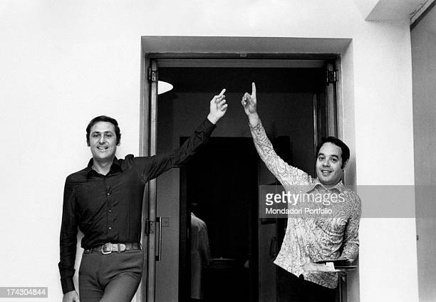 Renzo Arbore and Gianni Boncompagni the famous Italian radio broadcasters point at something on the doorway the two broadcasters continue their...