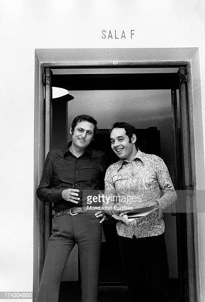 Renzo Arbore born Lorenzo John Arbore together with Gianni Boncompagni standing on the doorway of the room where they record the two Italian radio...