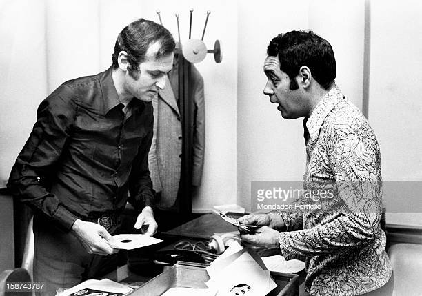 Renzo Arbore real name Lorenzo Giovanni Arbore with television author Gianni Boncompagni both holding vinyl records Rome 1970