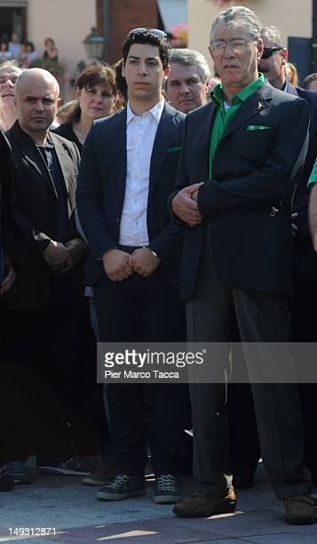 Renzo Bossi and Umberto Bossi attend the funeral of Cesarino Monti on July 26 2012 in Lazzate near Monza Italy