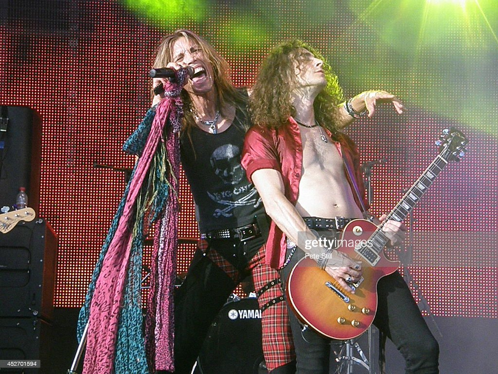Renzo D'Aprano and Davide Pola of italian Aerosmith tribute band Big Ones perform on stage at the Silverstone Classic at Silverstone on July 25, 2014 in Northampton, United Kingdom.