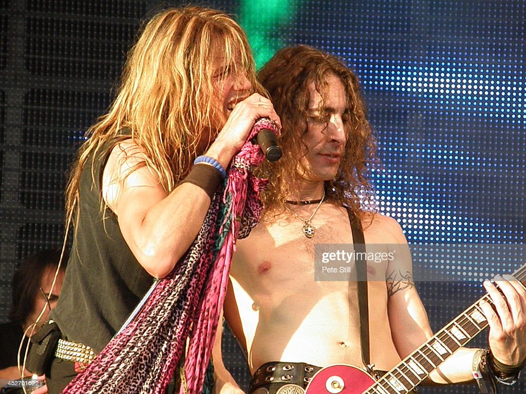 Renzo D'Aprano and Davide Pola of italian Aerosmith tribute band Big Ones perform on stage at Silverstone Classic at Silverstone on July 25, 2014 in Northampton, United Kingdom.