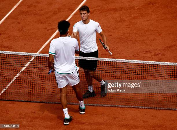 Renzo Olivo of Argentina and JoWilfried Tsonga of France shake hands following the first round match on day four of the 2017 French Open at Roland...