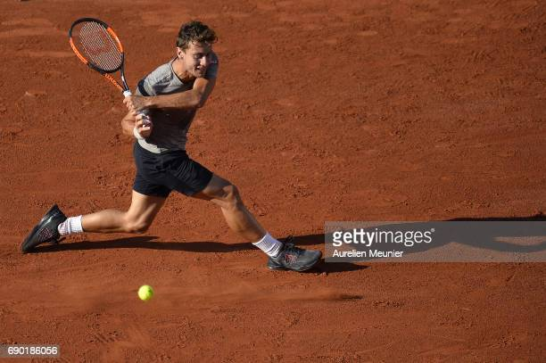 Renzo Olivo of Argentina plays a backhand during his men's single match against Jo Wilfried Tsonga of France on day three of the 2017 French Open at...
