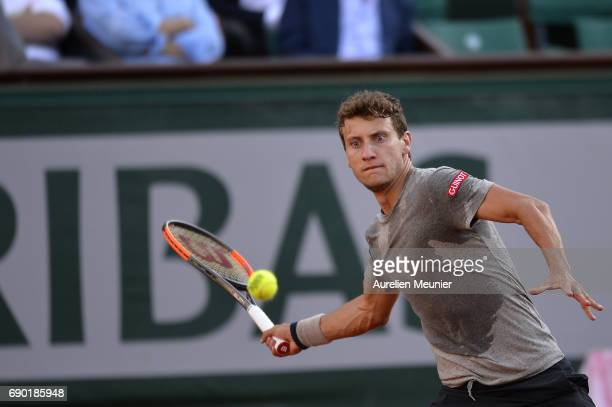 Renzo Olivo of Argentina plays a forehand during his men's single match against Jo Wilfried Tsonga of France on day three of the 2017 French Open at...