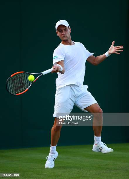 Renzo Olivo of Argentina plays a forehand during the Gentlemen's Singles first round match against Damir Dzumhur of Bosnia and Herzegovinia on day...