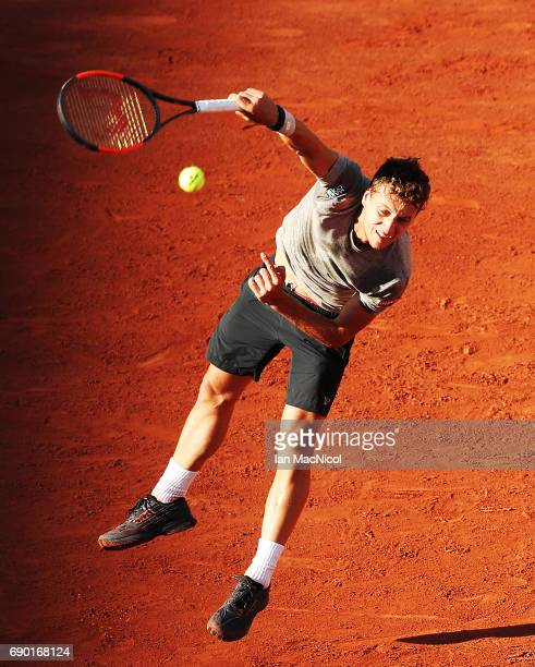 Renzo Olivo of Argentina serves during his match with JoWilfred Tsonga of France during Day Three at Roland Garros on May 30 2017 in Paris France