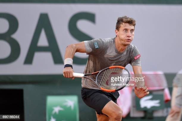 Renzo Olivo of Argentina sruns for the ball during his men's single match against Jo Wilfried Tsonga of France on day three of the 2017 French Open...