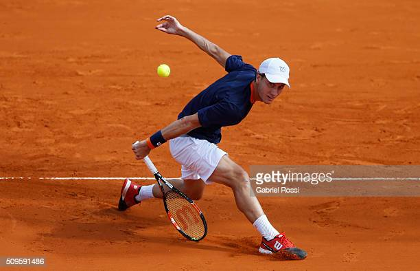 Renzo Olivo of Argentina takes a backhand shot during a match between David Ferrer of Spain and Renzo Olivo of Argentina as part of ATP Argentina...
