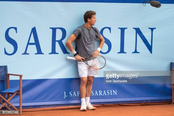 Renzo Olivo rests while court is being repaired during the ATP Swiss Open Gstaad on July 25 2017 at Roy Emerson Arena in Gstaad Switzerland
