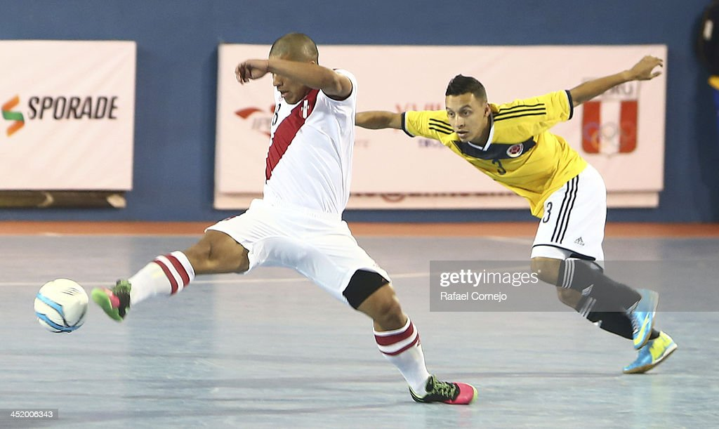 Renzo Ramirez of Peru fights for the ball with Luis Berreneche of Colombia during a match between Colombia and Peru as part of the XVII Bolivarian Games Trujillo 2013 at Videna San Luis on November 25, 2013 in Lima, Peru.
