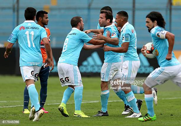 Renzo Revoredo of Sporting Cristal celebrates with teammates after scoring his team's first goal during a match between Sporting Cristal and Cesar...