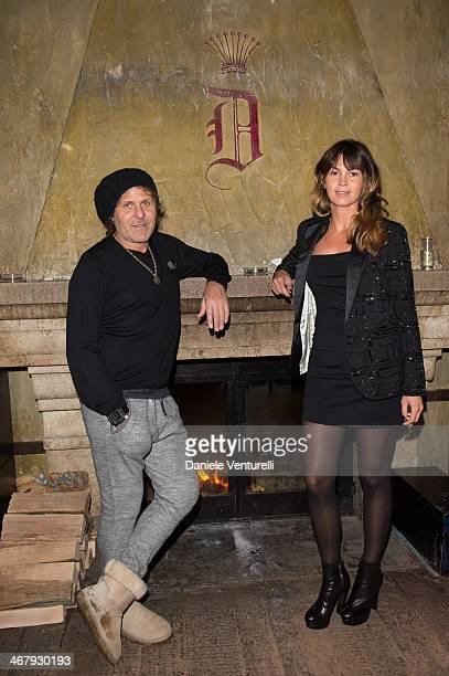 Renzo Rosso and Arianna Alessi attend the private dinner Host Dean and Dan Caten of Dsquared2 at Dracula's Club in St Moritz on February 8 2014 in St...