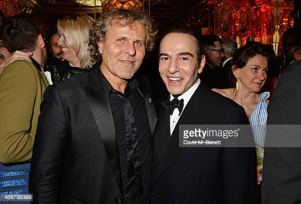 Renzo Rosso and John Galliano attend a party in celebration of Edward Enninful in The Oscar Wilde Bar Hotel Cafe Royal on December 1 2014 in London...