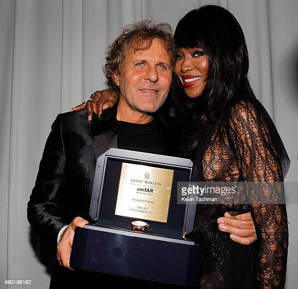 Renzo Rosso and Naomi Campbell attend amfAR Milano 2015 at La Permanente on September 26 2015 in Milan Italy