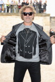 Renzo Rosso arrives at the Viktor Rolf show as part of the Paris Fashion Week Womenswear Spring/Summer 2014 at Espace Ephemere Tuileries on September...
