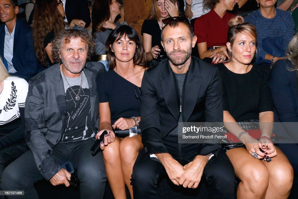 Renzo Rosso with his companion Arianna Lessi and his son Stefano Rosso with his wife Alessia attend the Viktor Rolf show as part of the Paris Fashion...