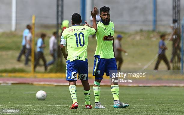 Renzo Sheput of Sporting Cristal celebrates with his teammate Josepmir Ballon after scoring the first goal of his team against Sport Huancayo during...