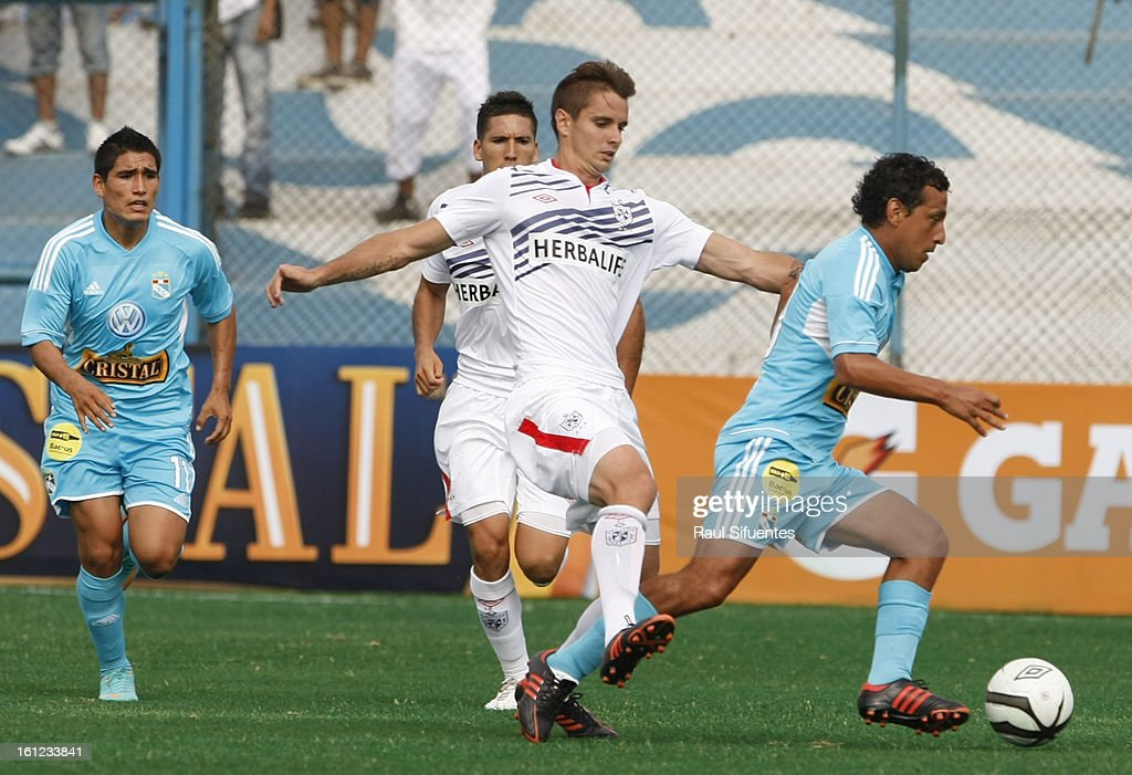 Renzo Sheput of Sporting Cristal fights for the ball with Benjamin Ubierna of San Martin during a match between Sporting Cristal and San Martin as part of The 2013 Torneo Descentralizado at the Alberto Gallardo Stadium on February 09, 2013 in Lima, Peru