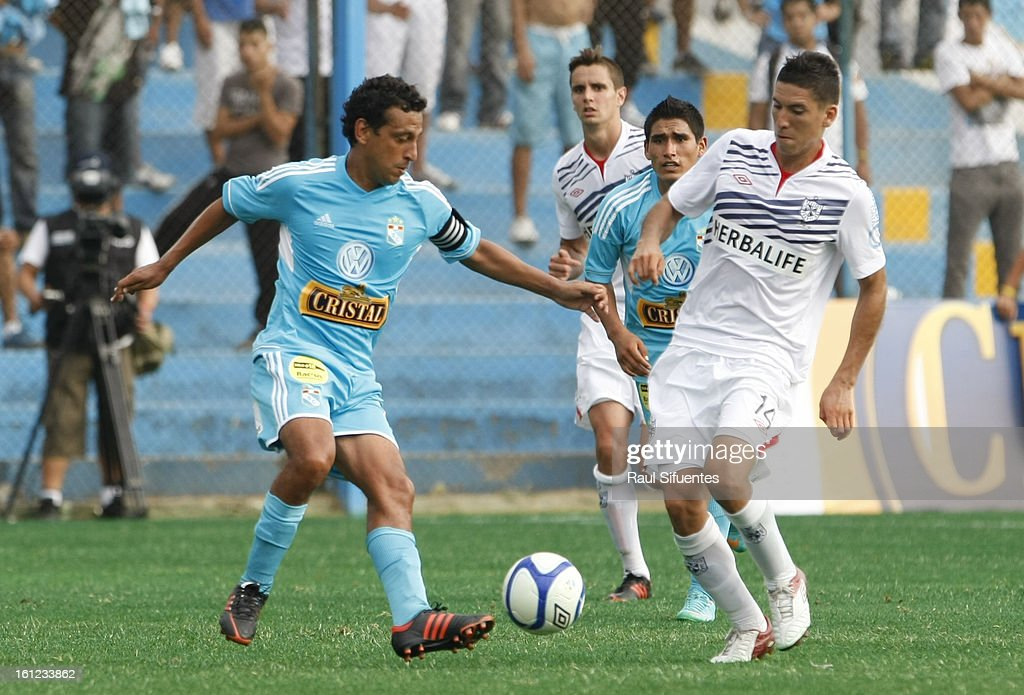 Renzo Sheput of Sporting Cristal fights for the ball with Luis Alvarez of San Martin during a match between Sporting Cristal and San Martin as part of The 2013 Torneo Descentralizado at the Alberto Gallardo Stadium on February 09, 2013 in Lima, Peru