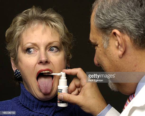 REO401/16/06118501Rick Eglinton Toronto StarDr Harold Katz of California shown testing individuals for bad breathNoteIndividual head shots of each...
