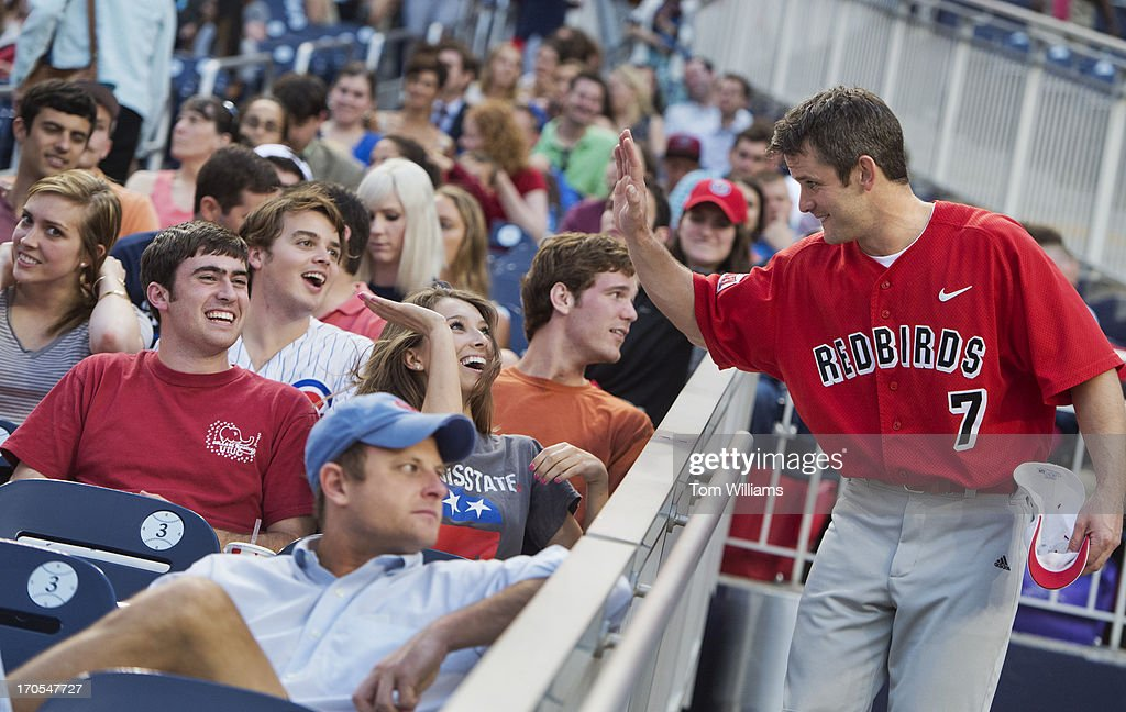 Rep. Adam Kinzinger, R-Ill., high fives his intern Ashley Breen during the Congressional Baseball game where the Democrats beat the Republicans 22-0 at Nationals Park.
