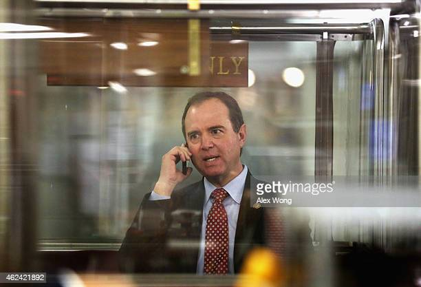 S Rep Adam Schiff talks on his phone while he is riding the House subway January 28 2015 on Capitol Hill in Washington DC Rep Schiff introduced a...