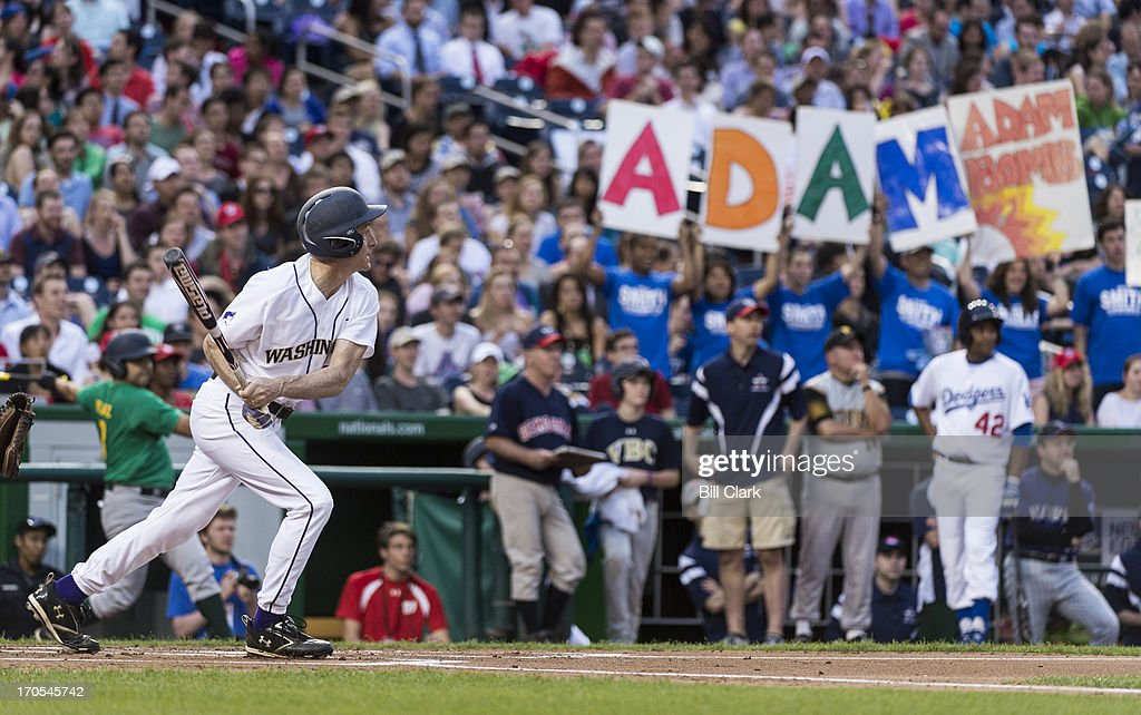 Rep. Adam Smith, D-Wash., bats during the 52nd annual Congressional Baseball Game at national Stadium in Washington on Thursday, June 13, 2013.