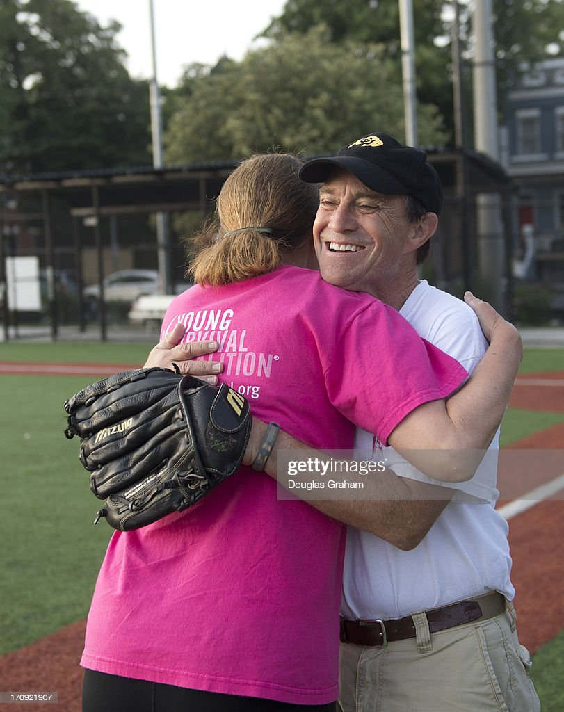 Rep. Ann Kirkpatrick, D-AZ., gives coach Rep. Ed Perlmutter, D-CO., a hug during the practice for the Congressional Womens Softball Game at Watkins Elementary in Washington, D. C. on June 20, 2013. The bi-partisan group of women Members of Congress take the field against the the women of the DC Press Corps to raise funds and awareness for young women with breast cancer and will be played on Wednesday, June 26, 2013.