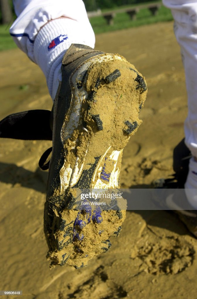 Rep. Anthony Weiner, D-NY, displays muddy cleats at the Demo ...