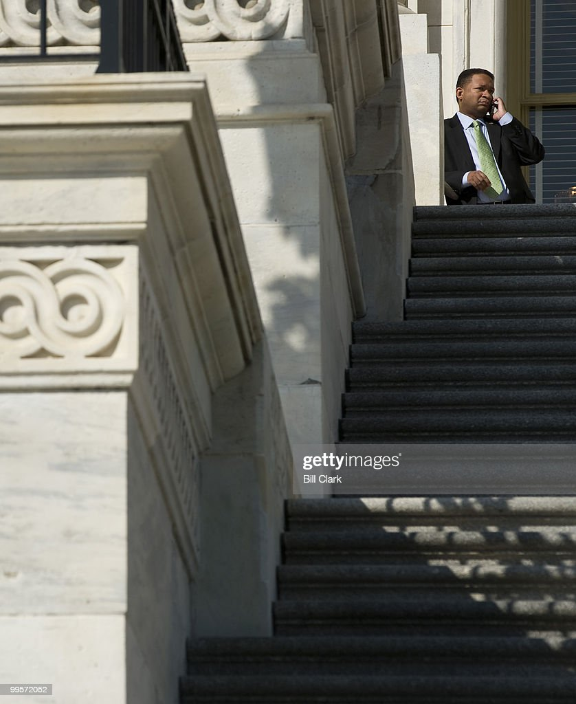 Rep Artur Davis DAla talks on his cell phone between votes at the top of the House steps on Friday March 19 2010