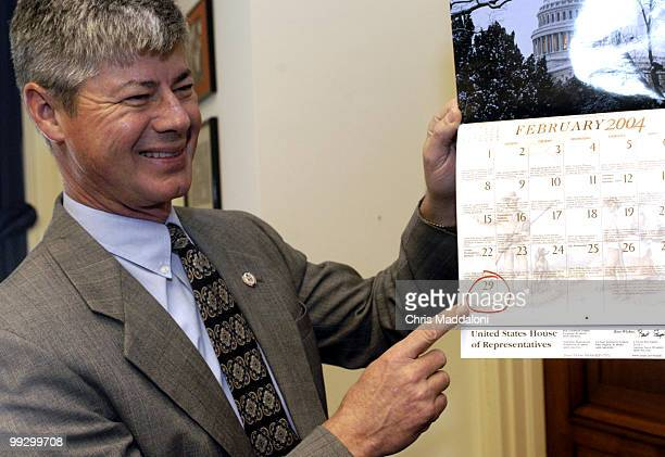 Rep Bart Stupak DMi points to the end of Feburary marking his Leap Year birthday in his office in Rayburn