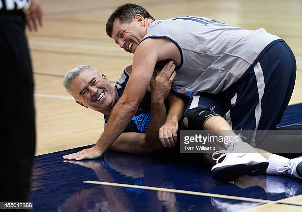 Rep Brad Wenstrup ROhio left is covered by lobbyist Danny Leonard during the Hoops for Youth 16th annual charity basketball game held at George...