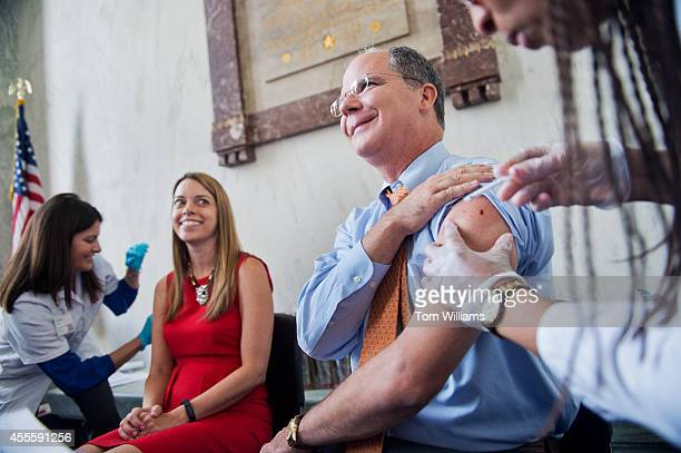 Rep Brett Guthrie RKy and Julie Philip of the National Association of Chain Drug Stores receive a flu vaccination during a health fair in Rayburn...