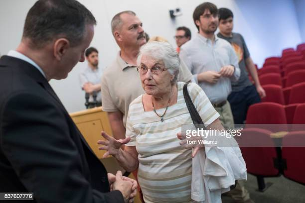 Rep Brian Fitzpatrick RPa talks with Alma Deal during a town hall meeting in Bensalem Pa on August 22 2017